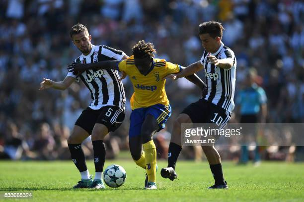 Miralem Pjanic and Paulo Dybala of Juventus try to stop an opponent during the preseason friendly match between Juventus A and Juventus B on August...