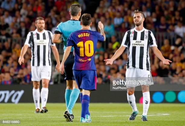 Miralem Pjanic Leo Messi and the referee Damir Skomina during Champions League match between FC Barcelona v RCD Juventus in Barcelona on September 12...