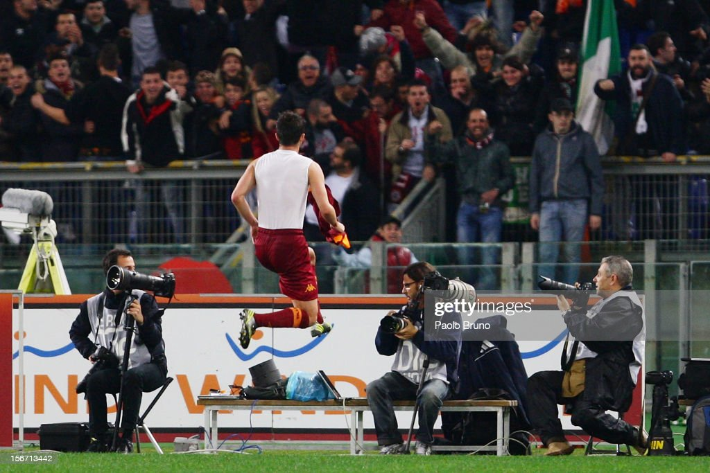 <a gi-track='captionPersonalityLinkClicked' href=/galleries/search?phrase=Miralem+Pjanic&family=editorial&specificpeople=4586190 ng-click='$event.stopPropagation()'>Miralem Pjanic</a> of AS Roma celebrates after scoring their second goal during the Serie A match between AS Roma and Torino FC at Stadio Olimpico on November 19, 2012 in Rome, Italy.