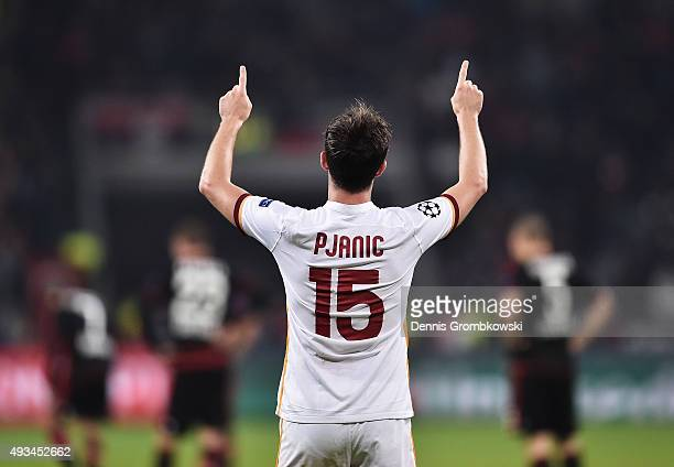 Miralem Pjanic of AS Roma celebrates as he scores their third goal during the UEFA Champions League Group E match between Bayer 04 Leverkusen and AS...