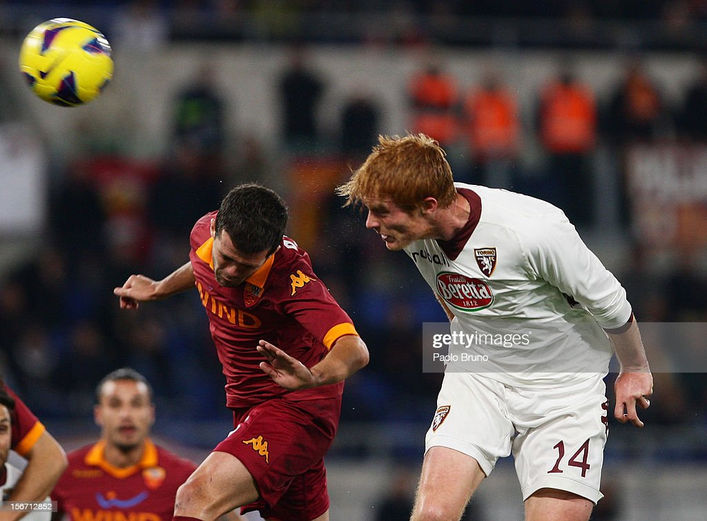 <a gi-track='captionPersonalityLinkClicked' href=/galleries/search?phrase=Miralem+Pjanic&family=editorial&specificpeople=4586190 ng-click='$event.stopPropagation()'>Miralem Pjanic</a> (L) of AS Roma competes for the ball with Alessandro Gazzi of Torino FC during the Serie A match between AS Roma and Torino FC at Stadio Olimpico on November 19, 2012 in Rome, Italy.
