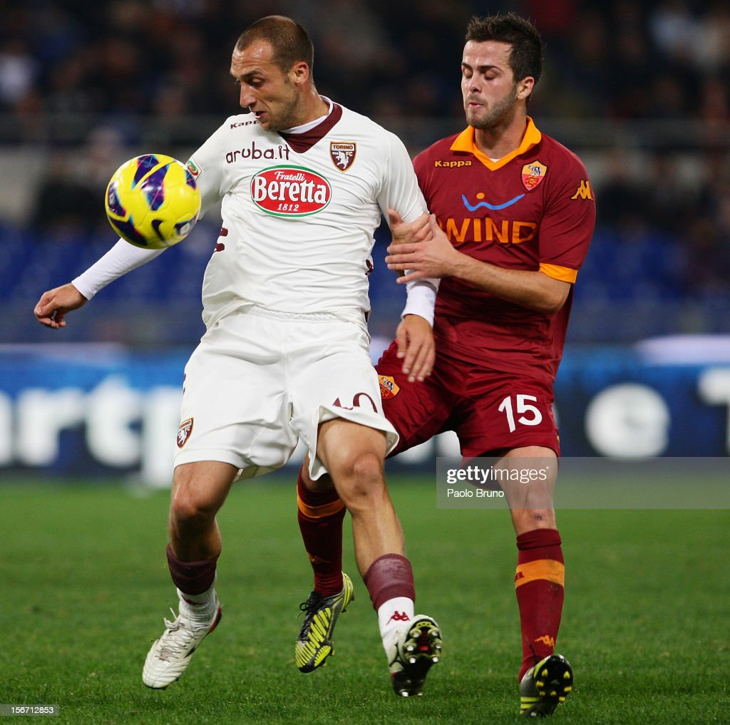 <a gi-track='captionPersonalityLinkClicked' href=/galleries/search?phrase=Miralem+Pjanic&family=editorial&specificpeople=4586190 ng-click='$event.stopPropagation()'>Miralem Pjanic</a> (R) of AS Roma competes for the ball with Alessandro Sgrigna of Torino FC during the Serie A match between AS Roma and Torino FC at Stadio Olimpico on November 19, 2012 in Rome, Italy.