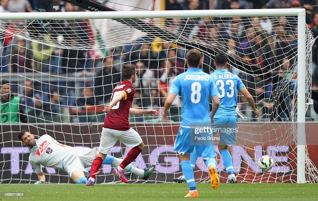 Miralem Pjanic of AS Roma scores the opening goal during the Serie A match between AS Roma and SSC Napoli at Stadio Olimpico on April 4, 2015 in Rome, Italy.