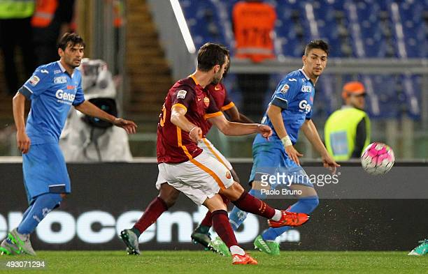 Miralem Pjanic of AS Roma scores the opening goal during the Serie A match between AS Roma and Empoli FC at Stadio Olimpico on October 17 2015 in...