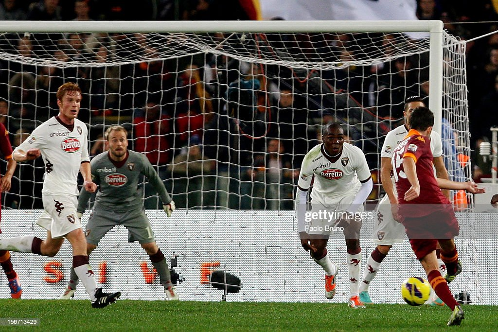 <a gi-track='captionPersonalityLinkClicked' href=/galleries/search?phrase=Miralem+Pjanic&family=editorial&specificpeople=4586190 ng-click='$event.stopPropagation()'>Miralem Pjanic</a> (R) of AS Roma scores their second goal during the Serie A match between AS Roma and Torino FC at Stadio Olimpico on November 19, 2012 in Rome, Italy.