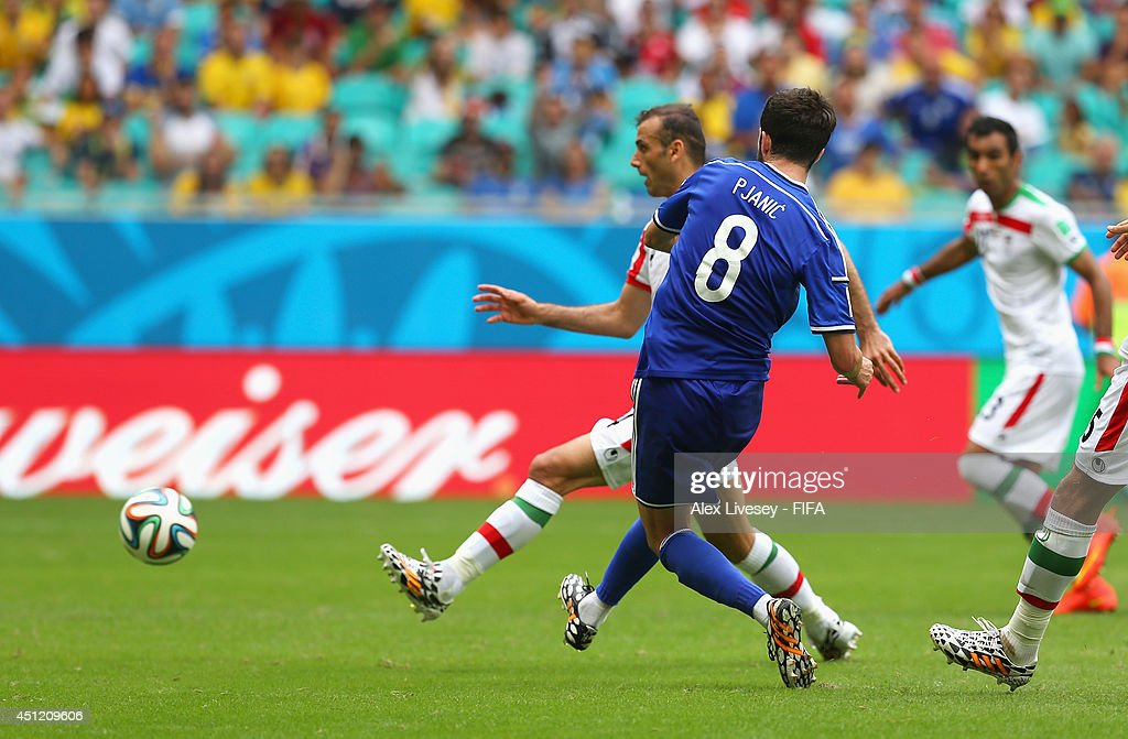<a gi-track='captionPersonalityLinkClicked' href=/galleries/search?phrase=Miralem+Pjanic&family=editorial&specificpeople=4586190 ng-click='$event.stopPropagation()'>Miralem Pjanic</a> of Bosnia and Herzegovina scores his team's second goal during the 2014 FIFA World Cup Brazil Group F match between Bosnia-Herzegovina and Iran at Arena Fonte Nova on June 25, 2014 in Salvador, Brazil.