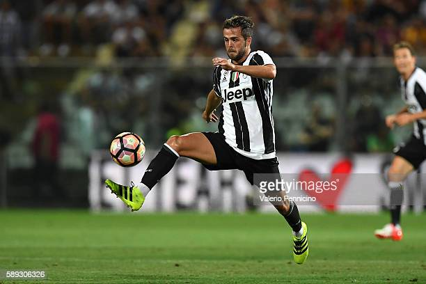 Miralem Pjanic of FC Juventus controls the ball during the PreSeason Friendly match between FC Juventus and Espanyol at Alberto Braglia Stadium on...