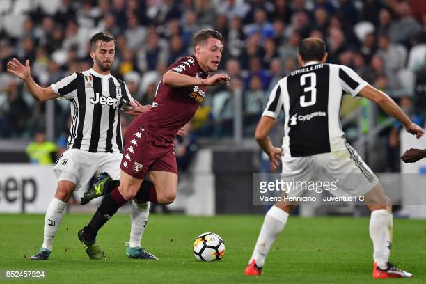 Miralem Pjanic of Juventus and Andrea Belotti of Torino in in action during the Serie A match between Juventus and Torino FC on September 23 2017 in...