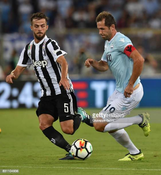 Miralem Pjanic of Juventus and Senad Lulic of SS Lazio in action during the Italian Supercup match between Juventus and SS Lazio at Stadio Olimpico...