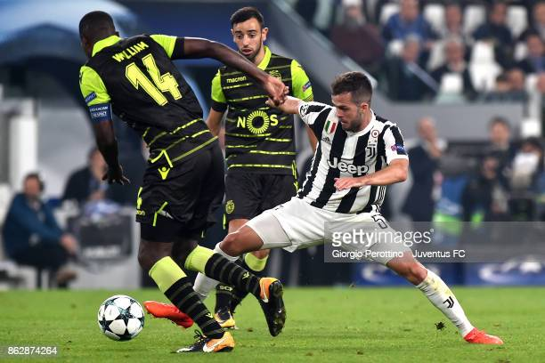 Miralem Pjanic of Juventus and William Carvalho of Sporting compete for the ball during the UEFA Champions League group D match between Juventus and...