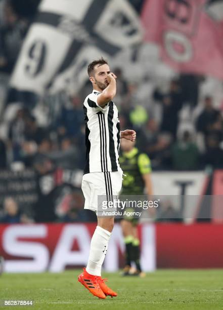 Miralem Pjanic of Juventus celebrates after scoring a goal during the UEFA Champions League group D football match between FC Juventus and Sporting...