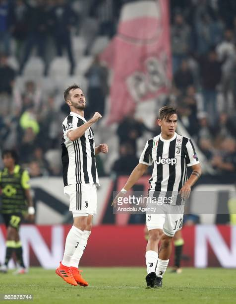 Miralem Pjanic of Juventus celebrates with his teammate Paulo Dybala after scoring a goal during the UEFA Champions League group D football match...
