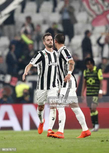 Miralem Pjanic of Juventus celebrates with his teammate Stefano Sturaro after scoring a goal during the UEFA Champions League group D football match...