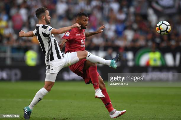 Miralem Pjanic of Juventus competes for the ball with Joao Pedro of Cagliari during the Serie A match between Juventus and Cagliari Calcio at Allianz...