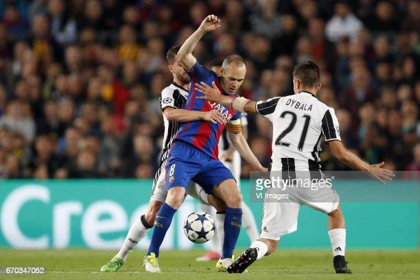 Miralem Pjanic of Juventus FC Andres Iniesta of FC Barcelona Paulo Dybala of Juventus FCduring the UEFA Champions League quarter final match between...
