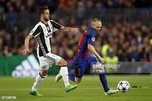 Miralem Pjanic of Juventus FC Andres Iniesta of FC Barcelonaduring the UEFA Champions League quarter final match between FC Barcelona and Juventus FC...