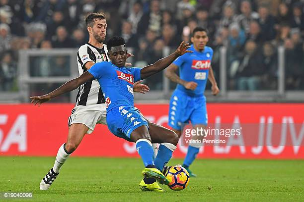 Miralem Pjanic of Juventus FC competes with Amadou Diawara of SSC Napoli during the Serie A match between Juventus FC and SSC Napoli at Juventus...
