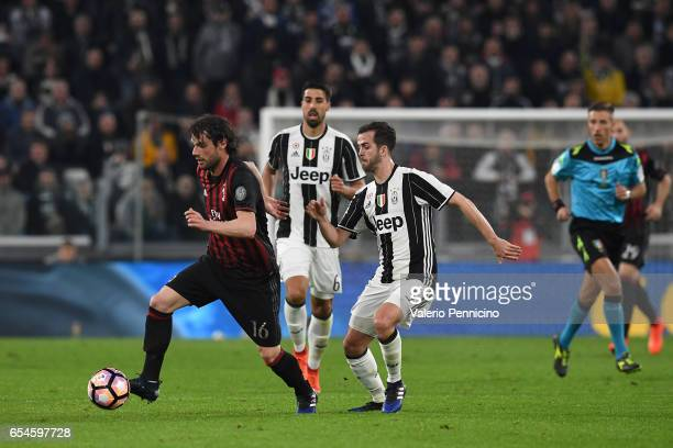 Miralem Pjanic of Juventus FC competes with Andrea Poli of AC Milan during the Serie A match between Juventus FC and AC Milan at Juventus Stadium on...