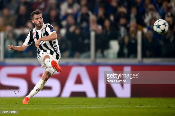Miralem Pjanic of Juventus FC scores a goal from a free kick during the UEFA Champions League football match between Juventus FC and Sporting CP...
