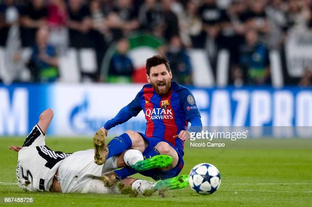 Miralem Pjanic of Juventus FC tackles Lionel Messi of FC Barcelona during the UEFA Champions League football match between Juventus FC and FC...