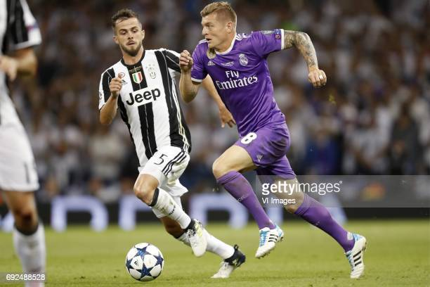 Miralem Pjanic of Juventus FC Toni Kroos of Real Madridduring the UEFA Champions League final match between Juventus FC and Real Madrid on June 3...