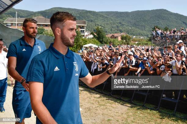 Miralem Pjanic of Juventus greets fans during the preseason friendly match between Juventus A and Juventus B on August 17 2017 in Villar Perosa Italy