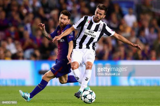 Miralem Pjanic of Juventus is challenged by Lionel Messi of FC Barcelona during the UEFA Champions League group D match between FC Barcelona and...