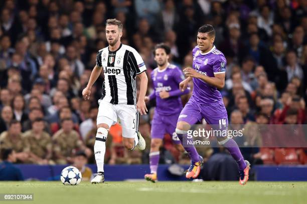 Miralem Pjanic of Juventus is followed by Casemiro of Real Madrid during the UEFA Champions League Final match between Real Madrid and Juventus at...