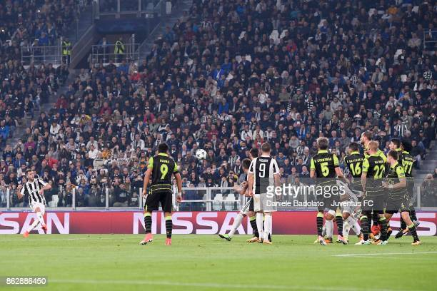 Miralem Pjanic of Juventus scores the goal during the UEFA Champions League group D match between Juventus and Sporting CP at Allianz Stadium on...