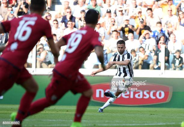 Miralem Pjanic of Juventus shoots the ballduring the Serie A match between Juventus and Cagliari Calcio at Allianz Stadium on August 19 2017 in Turin...