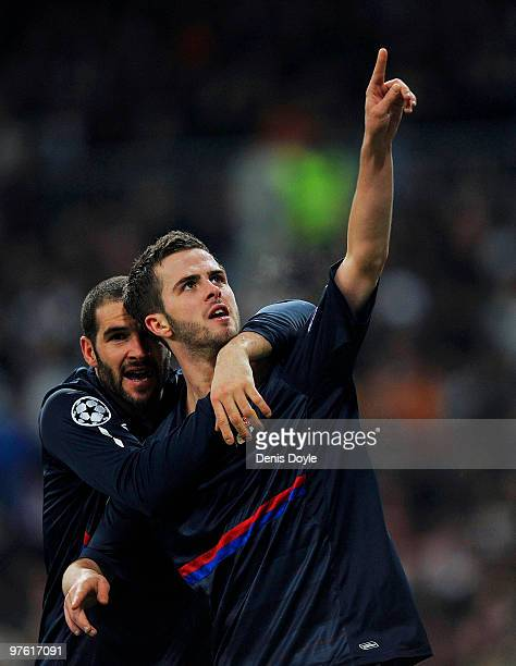 Miralem Pjanic of Olympique Lyonnais celebrates after scoring Lyonnais' first goal during the UEFA Champions League round of 16 2nd leg match between...