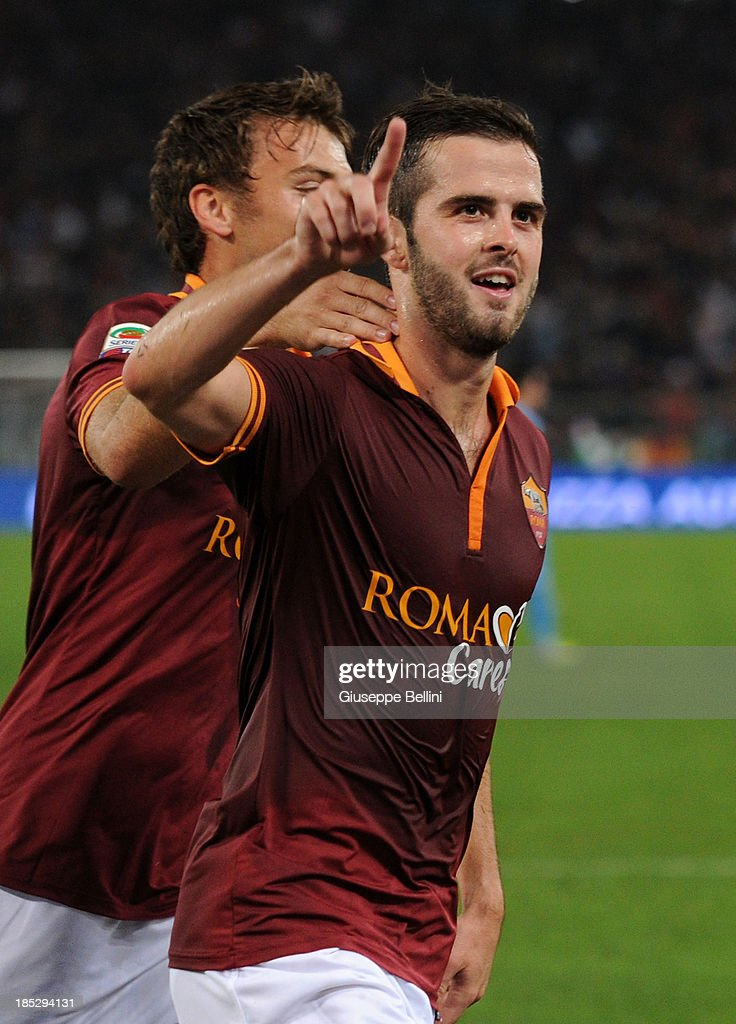 <a gi-track='captionPersonalityLinkClicked' href=/galleries/search?phrase=Miralem+Pjanic&family=editorial&specificpeople=4586190 ng-click='$event.stopPropagation()'>Miralem Pjanic</a> of Roma celebrates after scoring his team's second goal from a penalty during the Serie A match between AS Roma and SSC Napoli at Stadio Olimpico on October 18, 2013 in Rome, Italy.