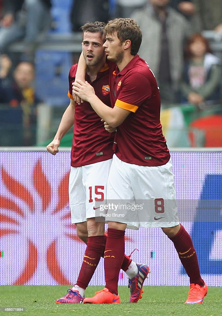 Miralem Pjanic (L) with his teammate Adem Ljajic of AS Roma celebrates after scoring the opening goal during the Serie A match between AS Roma and SSC Napoli at Stadio Olimpico on April 4, 2015 in Rome, Italy.