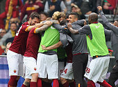 Miralem Pjanic with his teammates of AS Roma celebrates after scoring the opening goal during the Serie A match between AS Roma and SSC Napoli at...