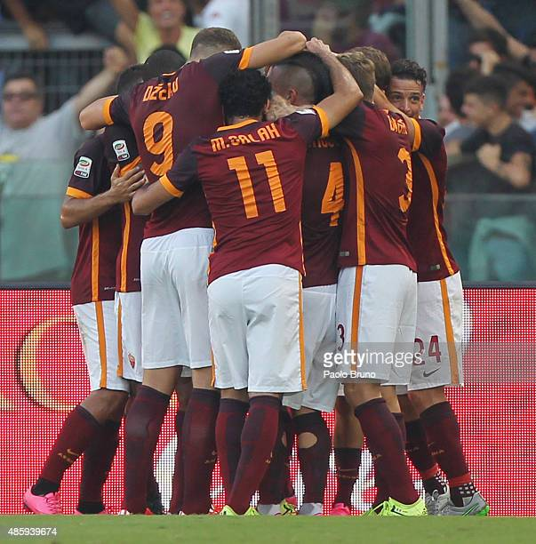 Miralem Pjanic with his teammates of AS Roma celebrates after scoring the opening goal during the Serie A match between AS Roma and Juventus FC at...