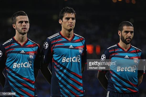 Miralem Pjanic Yoann Gourcuff and Lisandro of Lyon line up before the UEFA Champions League Group B match between Olympique Lyonnais and FC Schalke...