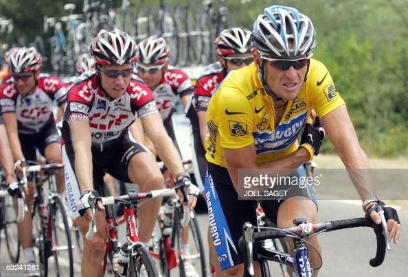 Yellow jersey US Lance Armstrong rides in front of Danish CSC team during the 13th stage of the 92nd Tour de France cycling race between Miramas and...
