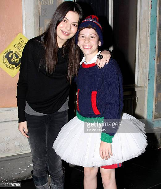 Miranda Cosgrove and David Bologna pose backstage at 'Billy Elliot The Musical' on Broadway at the Imperial Theatre on September 15 2009 in New York...