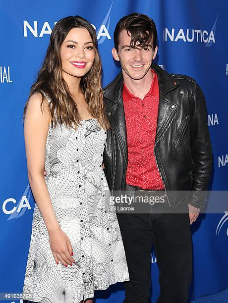 Miranda Cosgrove and Drake Bell attend the Nautica and LA Confidential's Oceana Beach House Party on May 16 2014 in Santa Monica California