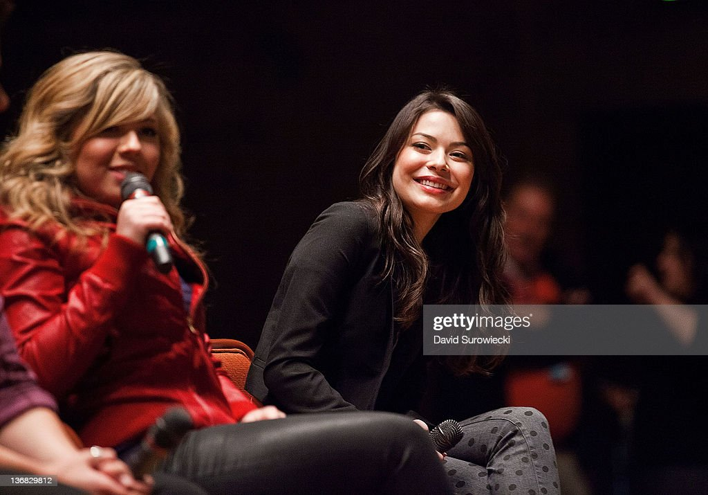 Miranda Cosgrove (R) smiles as Jennette McCurdy addresses the crowd during a question and answer session at Naval Submarine Base New London on January 11, 2012 in Groton, Connecticut. The cast of Nickelodeon's iCarly were presenting a special military family screening of iMeet The First Lady, an episode of their show featuring Michelle Obama.