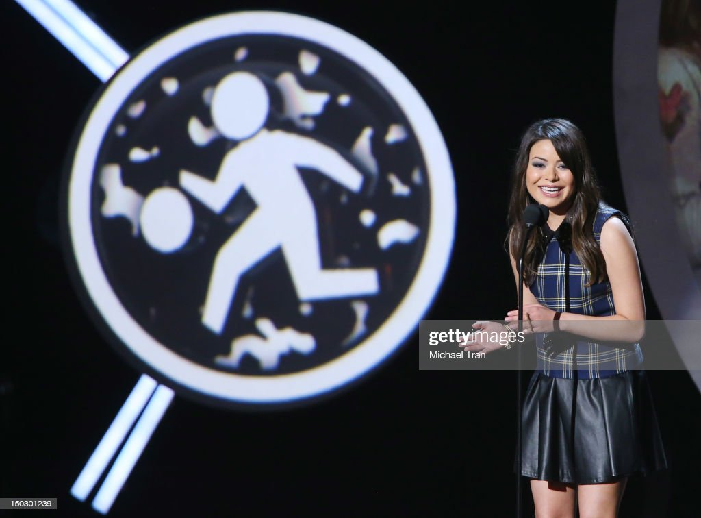 Miranda Cosgrove speaks onstage at the 'Teachers Rock' benefit event held at Nokia Theatre L.A. Live on August 14, 2012 in Los Angeles, California.