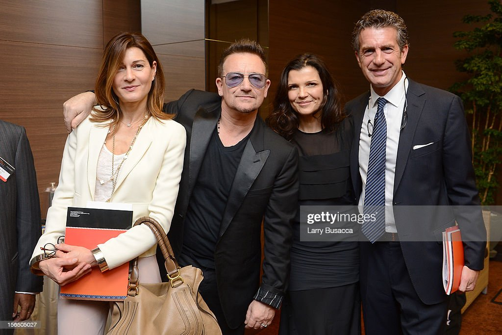 Miranda Dunbar-Johnson, Bono, Alison Hewson and Stephen Dunbar-Johnson, International Herald Tribune Publisher, attend the third day of the 2012 International Herald Tribune's Luxury Business Conference held at Rome Cavalieri on November 16, 2012 in Rome, Italy. The 12th annual IHT Luxury conference is the premier meeting point for the luxury industry. 500 delegates from 30 countries have gathered in Rome to hear from the world's most inspirational fashion designers and luxury business leaders.
