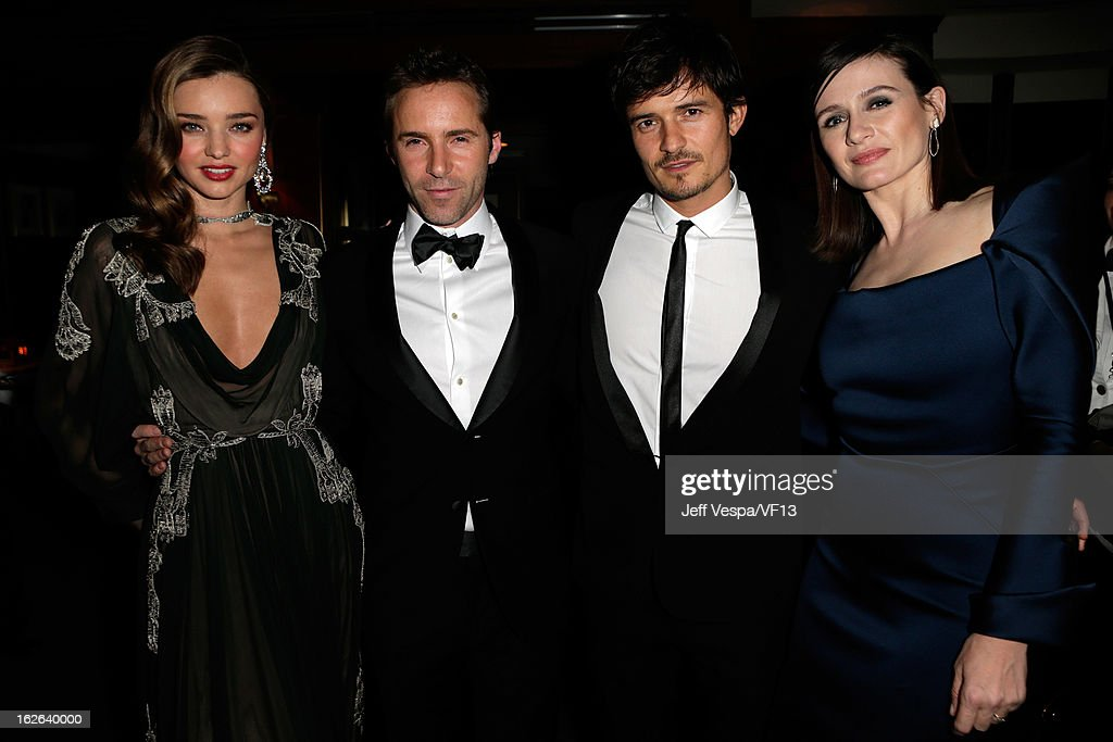 Miranda Kerr, Alessandro Nivola, Orlando Bloom, and Emily Mortimer attend the 2013 Vanity Fair Oscar Party hosted by Graydon Carter at Sunset Tower on February 24, 2013 in West Hollywood, California.