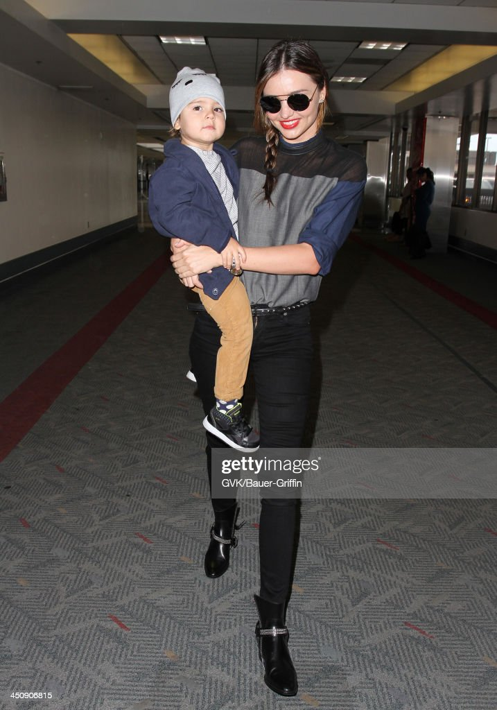 <a gi-track='captionPersonalityLinkClicked' href=/galleries/search?phrase=Miranda+Kerr&family=editorial&specificpeople=5714330 ng-click='$event.stopPropagation()'>Miranda Kerr</a> and baby Flynn Christopher Bloom are seen arriving at LAX airport on November 20, 2013 in Los Angeles, California.