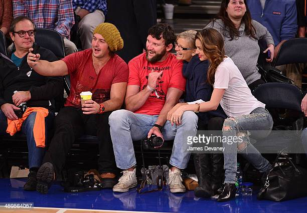Miranda Kerr and guests attend the Toronto Raptors vs New York Knicks game at Madison Square Garden on December 27 2013 in New York City