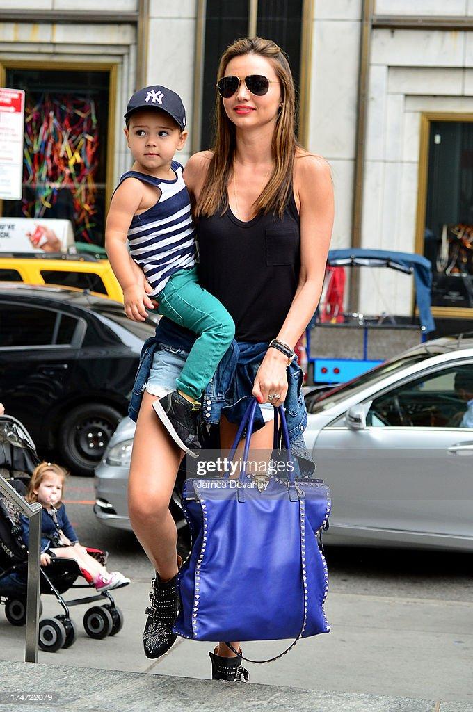 Miranda Kerr and son Flynn Bloom arrive to FAO Schwarz on July 28, 2013 in New York City.