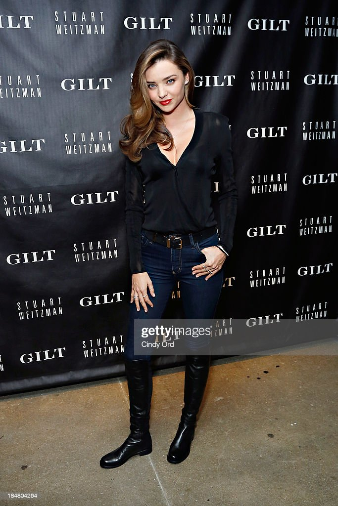 <a gi-track='captionPersonalityLinkClicked' href=/galleries/search?phrase=Miranda+Kerr&family=editorial&specificpeople=5714330 ng-click='$event.stopPropagation()'>Miranda Kerr</a> attends as Gilt And Stuart Weitzman celebrate the 5050 Boot 20th anniversary on October 16, 2013 in New York City.