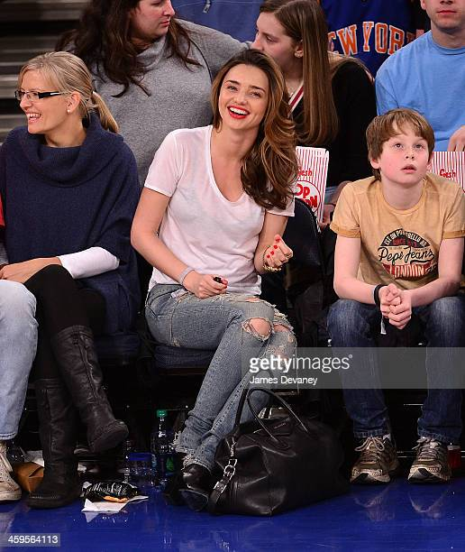 Miranda Kerr attends the Toronto Raptors vs New York Knicks game at Madison Square Garden on December 27 2013 in New York City
