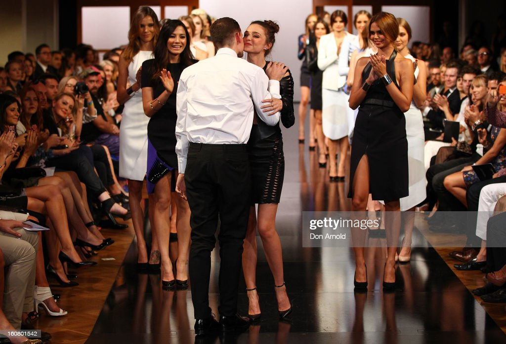 <a gi-track='captionPersonalityLinkClicked' href=/galleries/search?phrase=Miranda+Kerr&family=editorial&specificpeople=5714330 ng-click='$event.stopPropagation()'>Miranda Kerr</a> greets Dion Lee as she showcases designs by Dion Lee on the catwalk during the David Jones A/W 2013 Season Launch at David Jones Castlereagh Street on February 6, 2013 in Sydney, Australia.