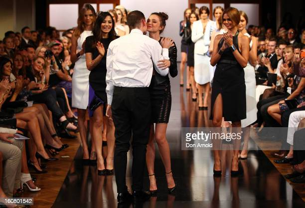 Miranda Kerr greets Dion Lee as she showcases designs by Dion Lee on the catwalk during the David Jones A/W 2013 Season Launch at David Jones...